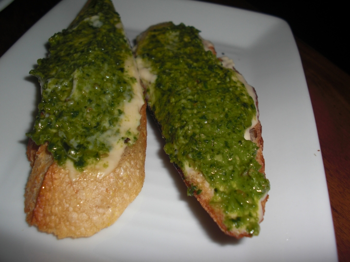 Goat cheese, roasted garlic, and pesto bruchetta