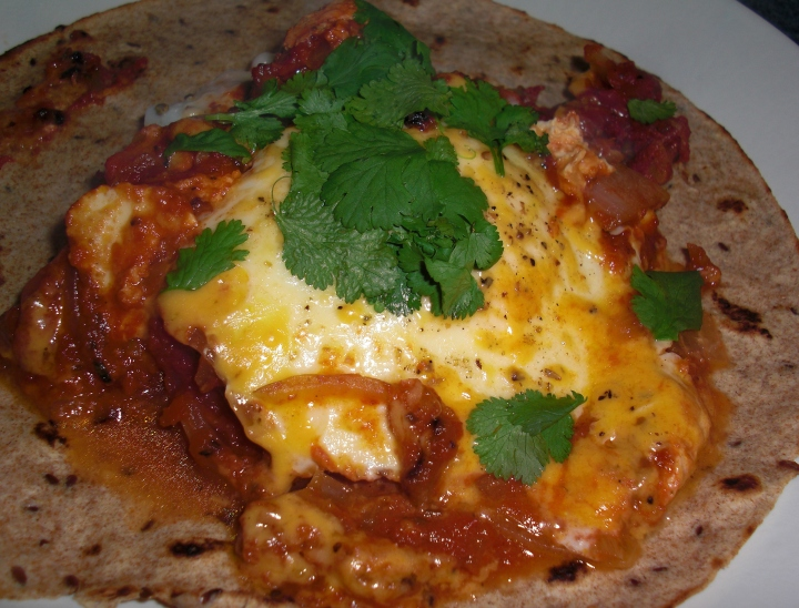 Huevos Ranceros with chili sauce