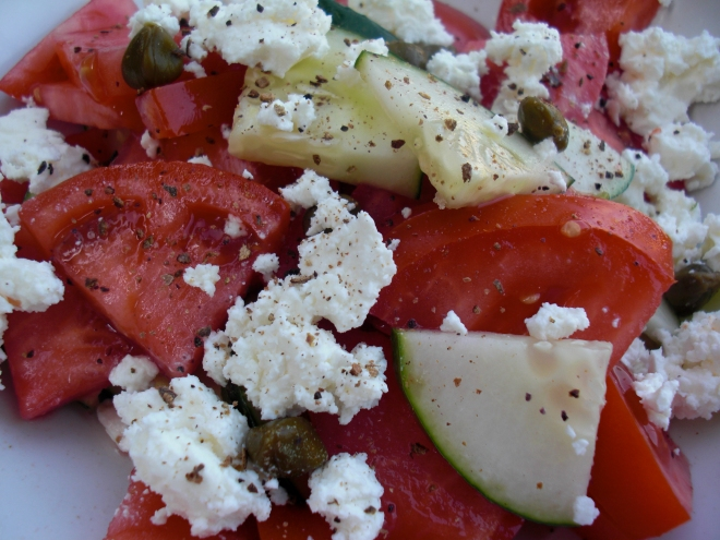 Tomato Salad with cucumbers, goat cheese, and capers